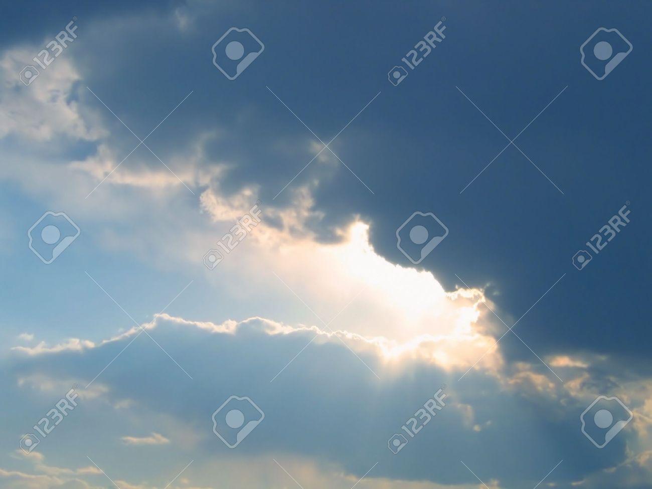 rain cloud and rays of sunlight - 14292390