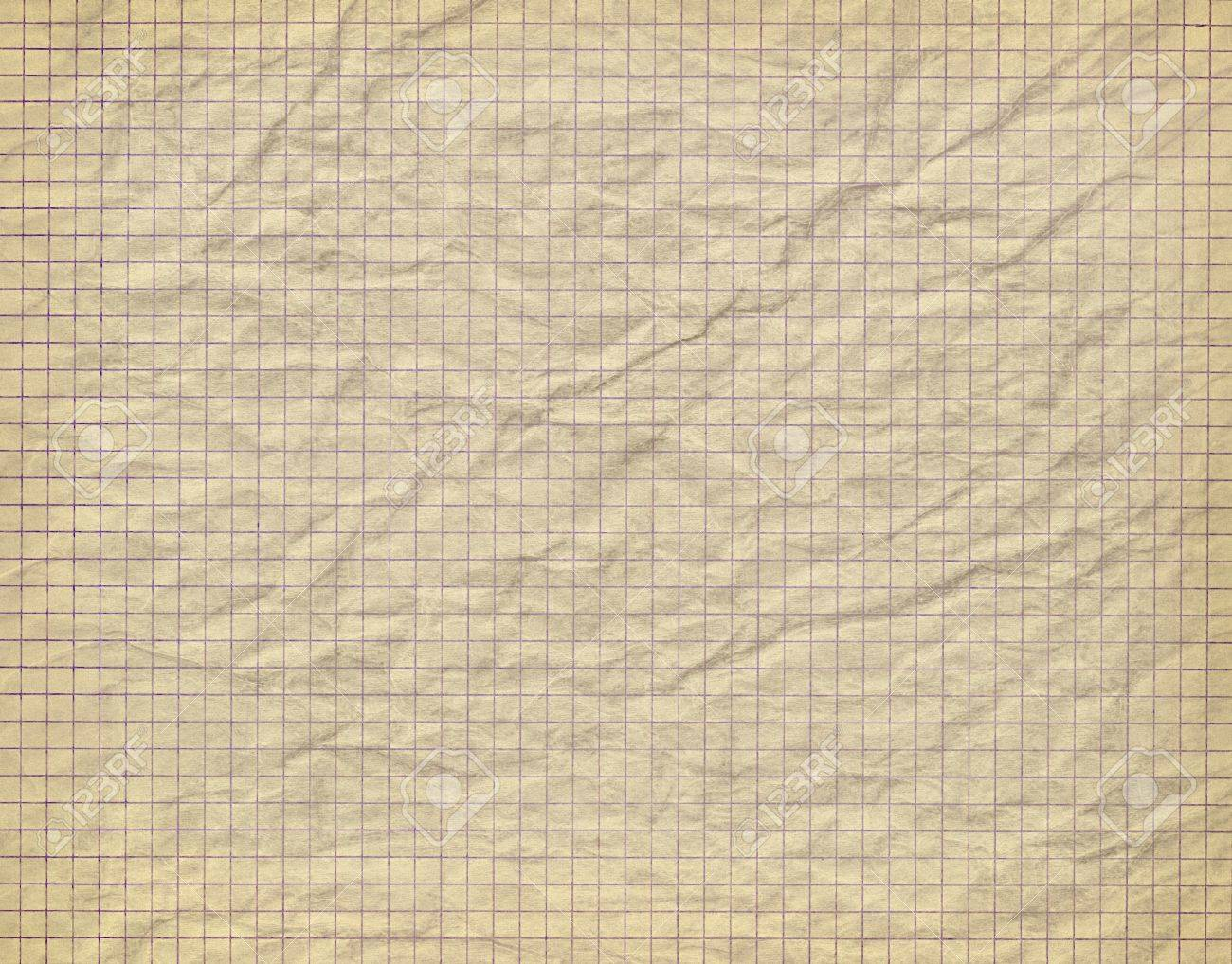 Old crumpled checkered paper background - 14557294