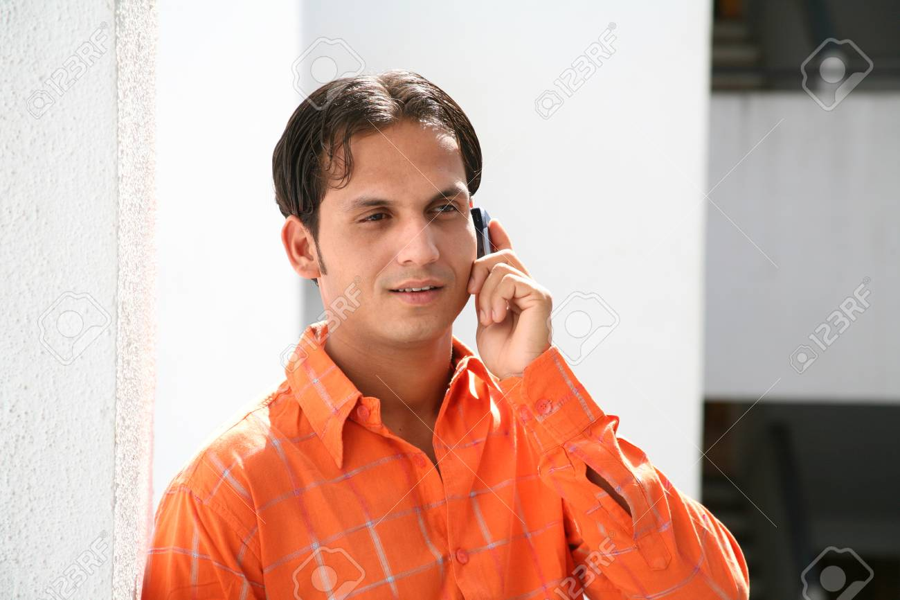 b385649ad5 South Asian Indian young man talking on mobile phone Stock Photo - 85731954