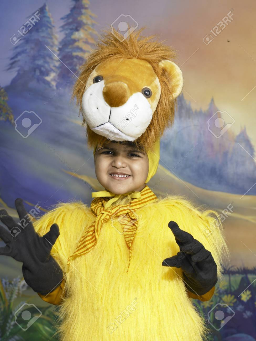 af13e376fe South Asian Indian boy dressed as lion performing fancy dress competition  on stage in nursery school