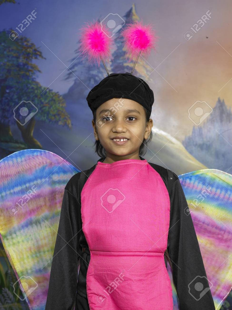 4fcebd85bd South Asian Indian girl dressed as butterfly performing fancy dress  competition on stage in nursery school