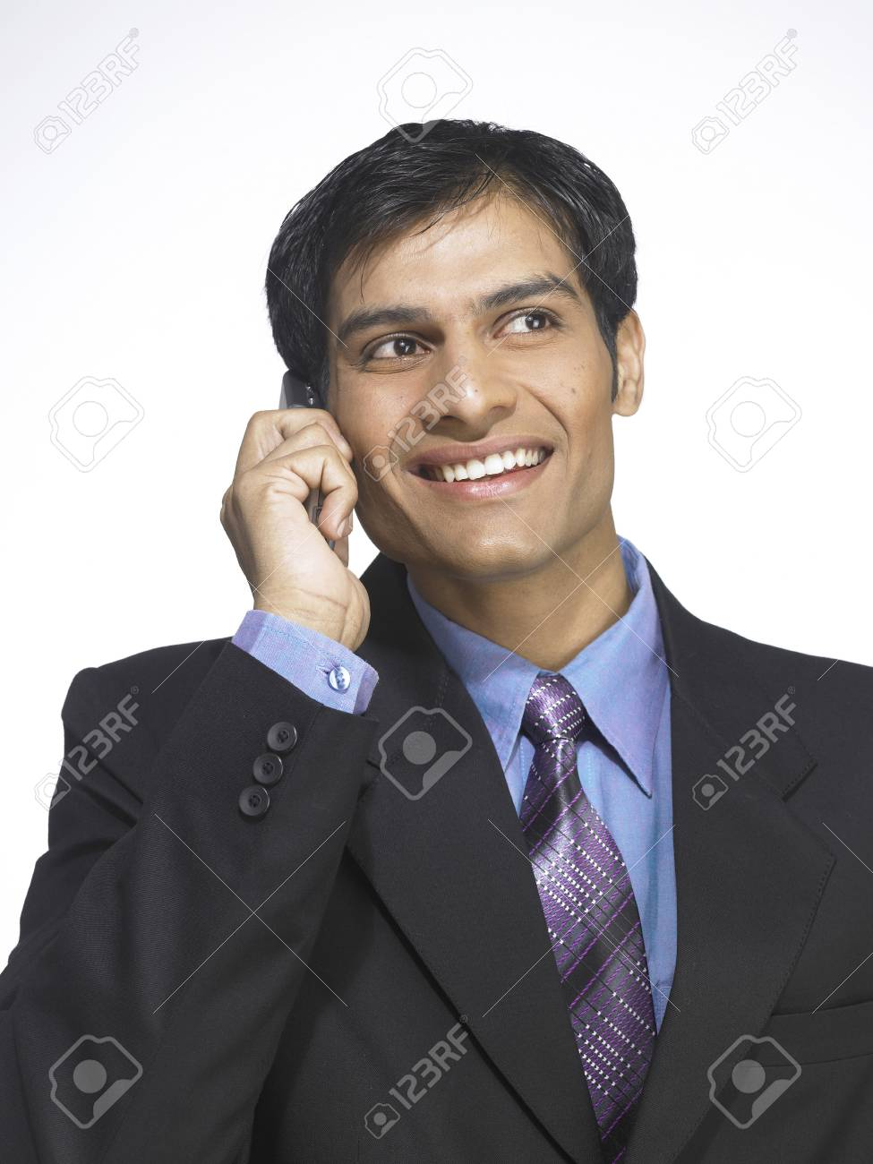 1c7d27d306 South Asian Indian executive man talking on mobile phone Stock Photo -  85736243