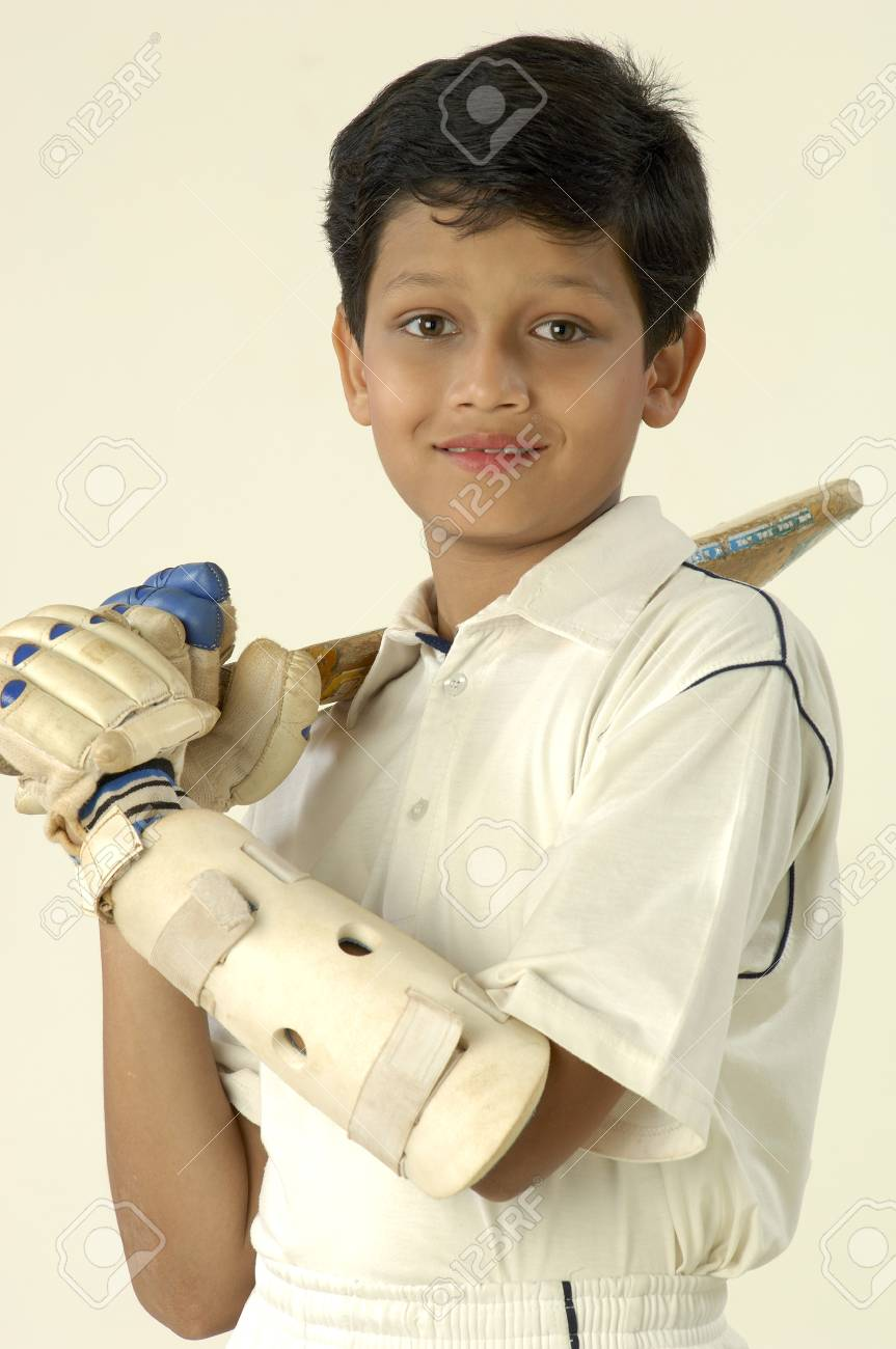 South Asian Indian boy wearing cricket costume with bat in hand Stock Photo - 85737649  sc 1 st  123RF.com & South Asian Indian Boy Wearing Cricket Costume With Bat In Hand ...