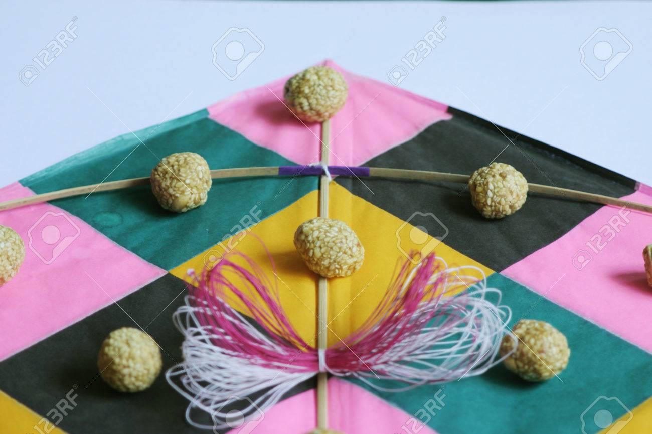 Festival of India,Makara sankranti,kites thread and til laddoos or jaggery and sesame balls,Maharashtra,India - 85740612