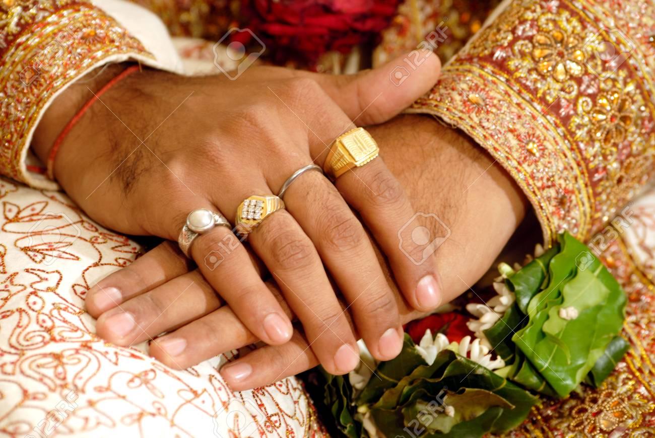 South Asian Indian Hindu Wedding Ceremonyclose Up Of Hands Cross