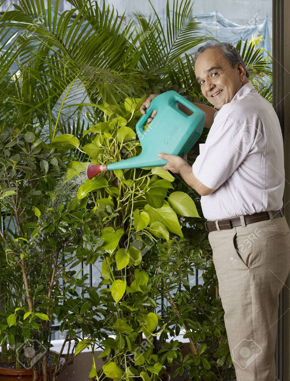 Old Man Watering Plants Stock Photo Picture And Royalty Free