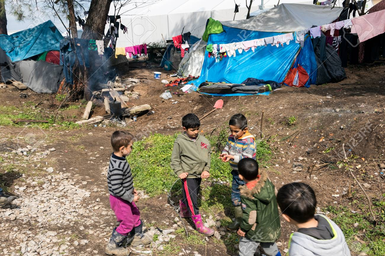 Boys play near their tents on March 17, 2015 in the refugee camp of Idomeni, Greece. For several weeks, more than 10.000 refugees and immigrants wait here for the borders to open. - 61169151