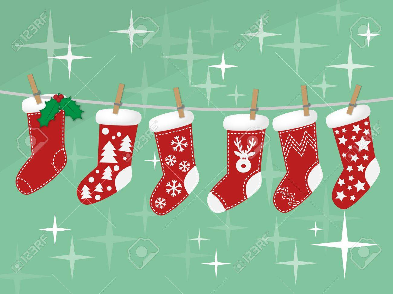 Christmas Socks Hanging On Rope On Green Background