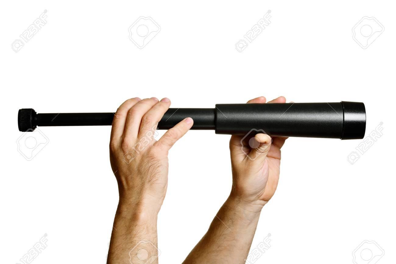 Monocular teleskop in mannhände isoliert auf weiss lizenzfreie