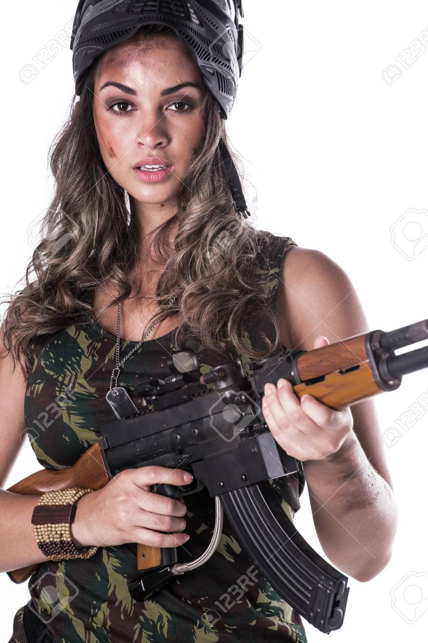 Woman in military uniform with a gun - 53763375