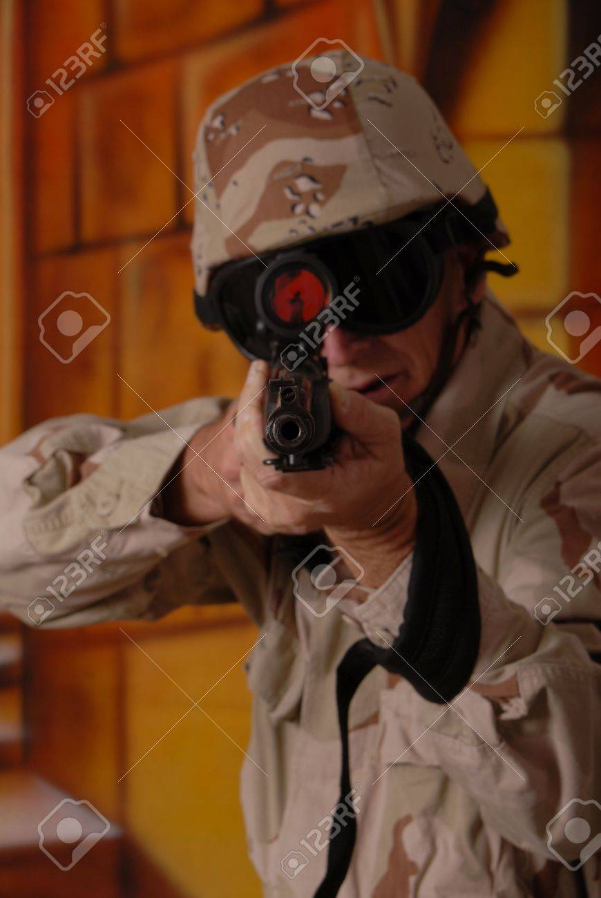 Camouflaged old soldier with sniper rifle inside building Stock Photo - 566247