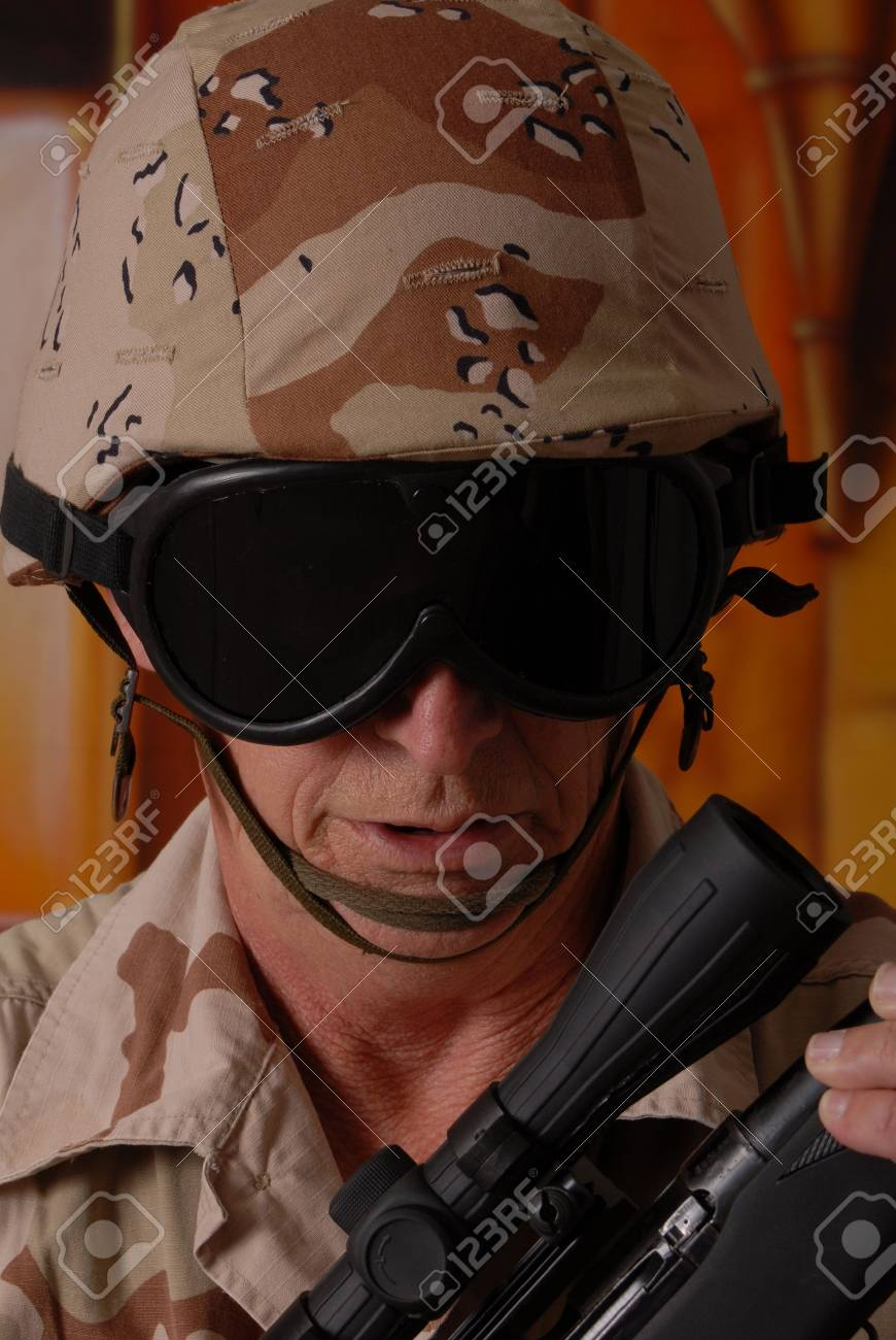 Camouflaged old soldier with sniper rifle inside building Stock Photo - 566250