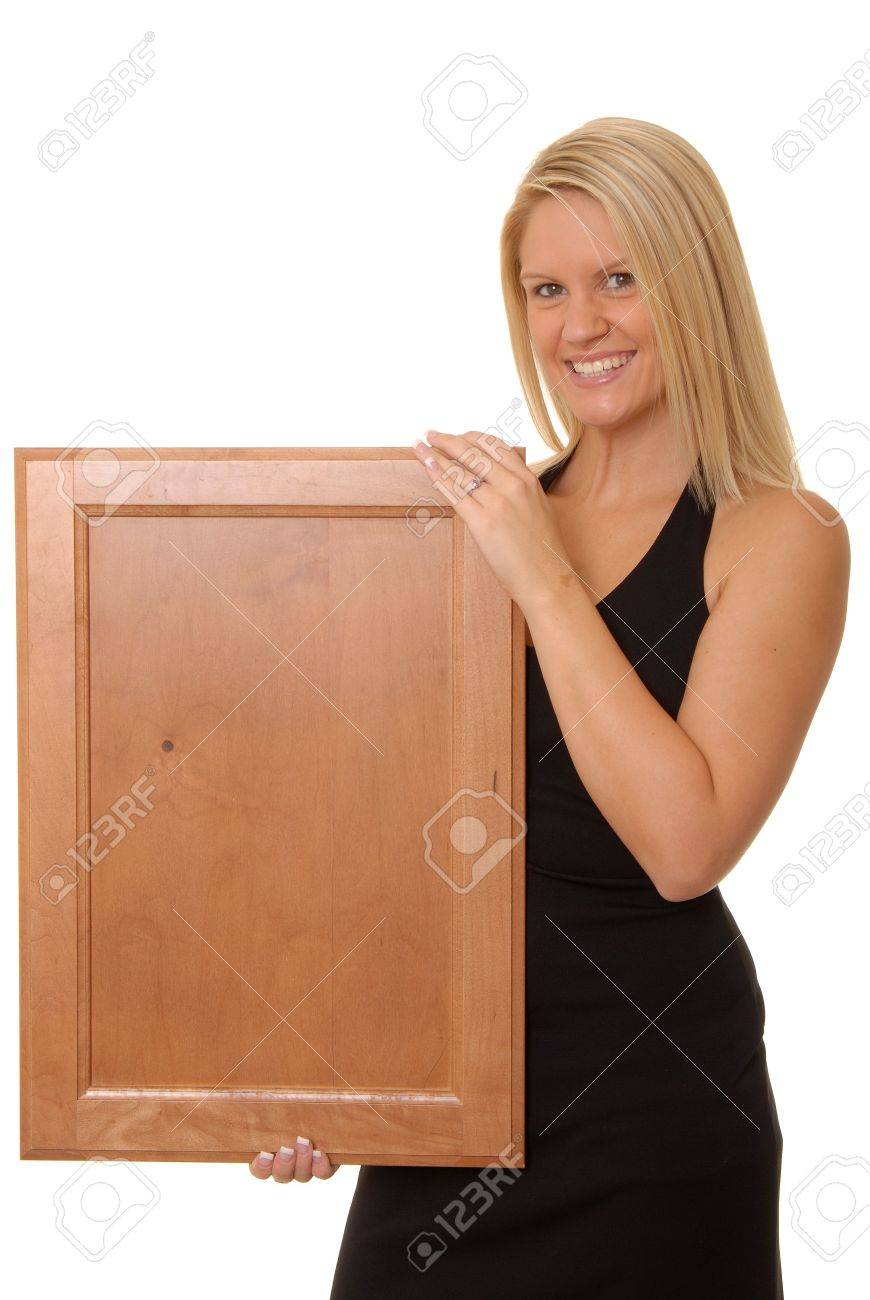 Beautiful and sexy young blond girl isolatedholding a vlank wooden sign Stock Photo - 622886