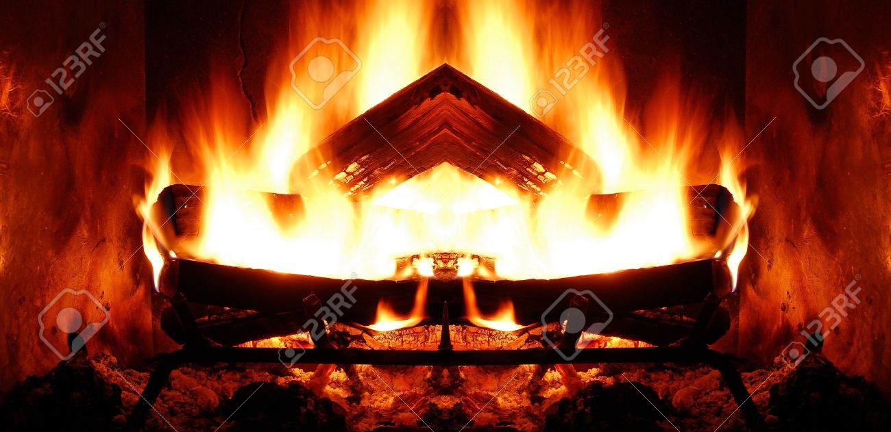 closeup of roaring log fire in fireplace stock photo picture and