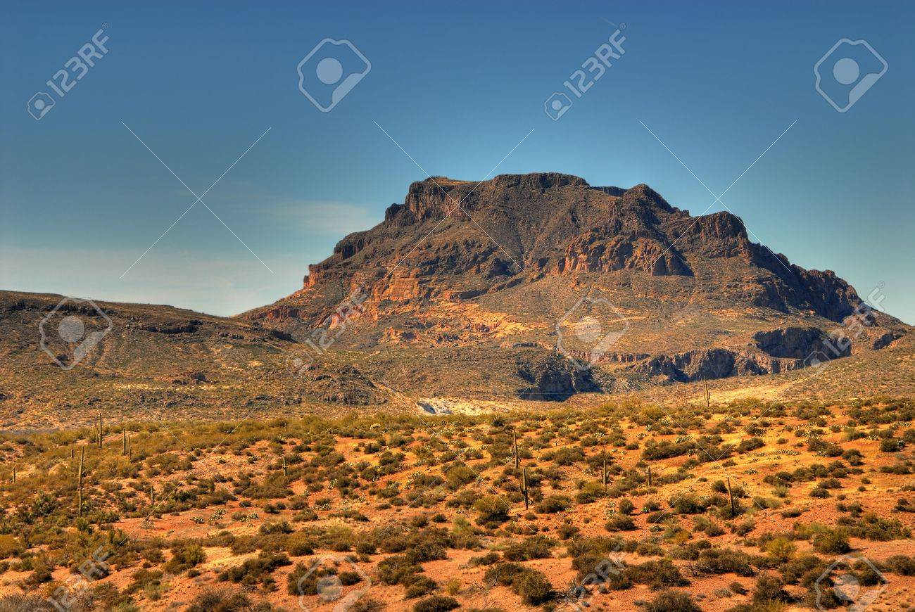 Dramatic desert mountains with a deep blue sky Stock Photo - 772386