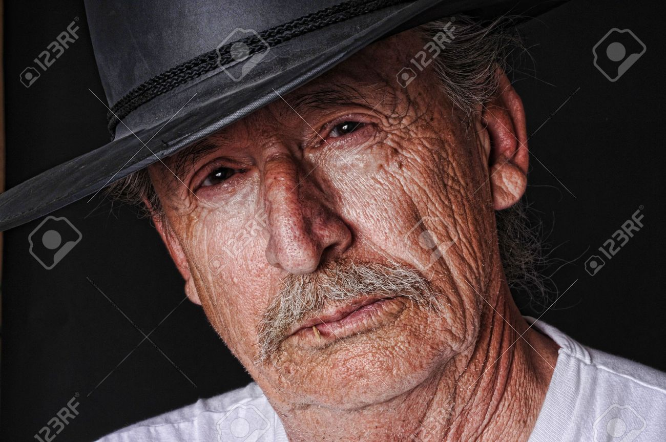 Portrait of an old cowboy with a toothpick in his mouth Stock Photo - 8932972