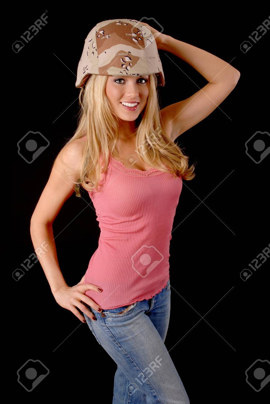 Isolated lovely and sexy young blond girl wearing a military helmet Stock Photo - 8931482