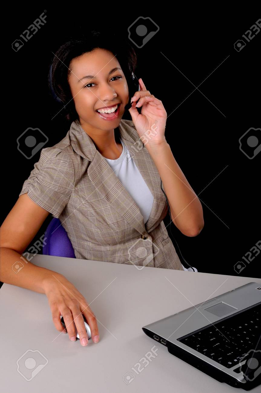 Lovely African American business woman working at computer laptop Stock Photo - 9016027