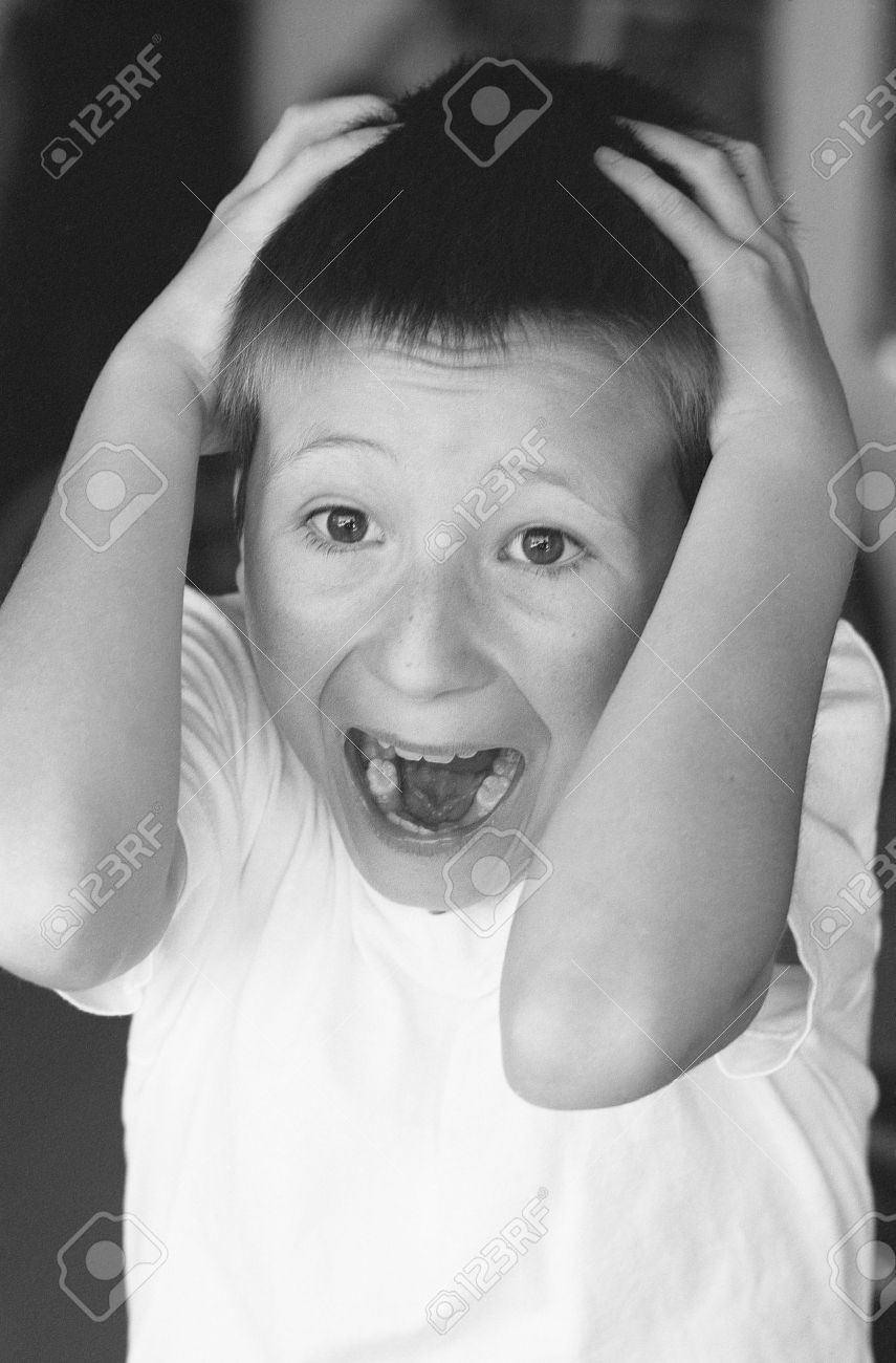 Black and white of a scared young boy Stock Photo - 9724289