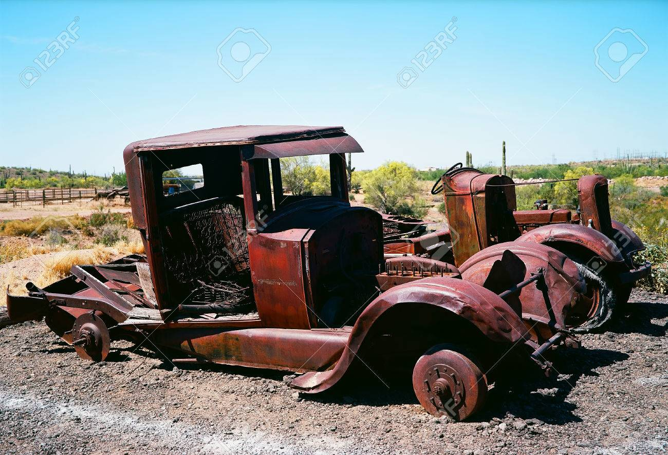 Broken Down And Rusty Old Trucks With No Tires In The Desert Stock ...