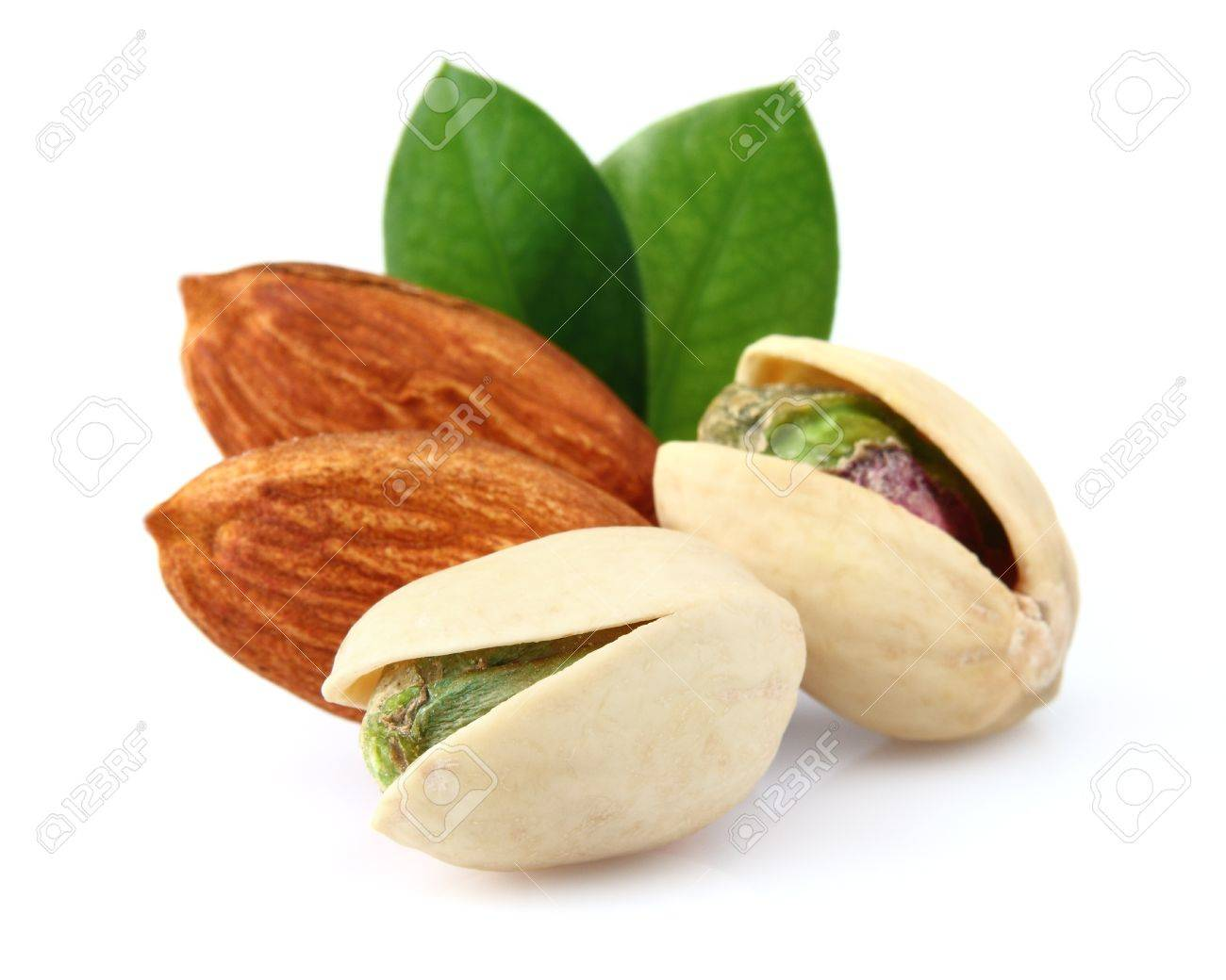 Pistachio and almonds with leaves Stock Photo - 12882233