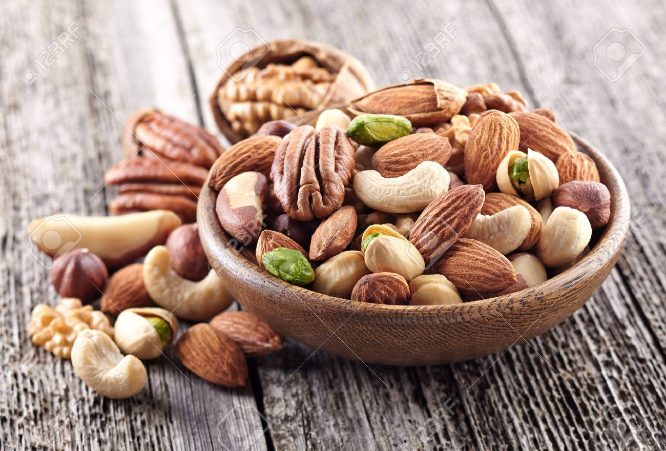 Nuts mix in a wooden plate - 51284146