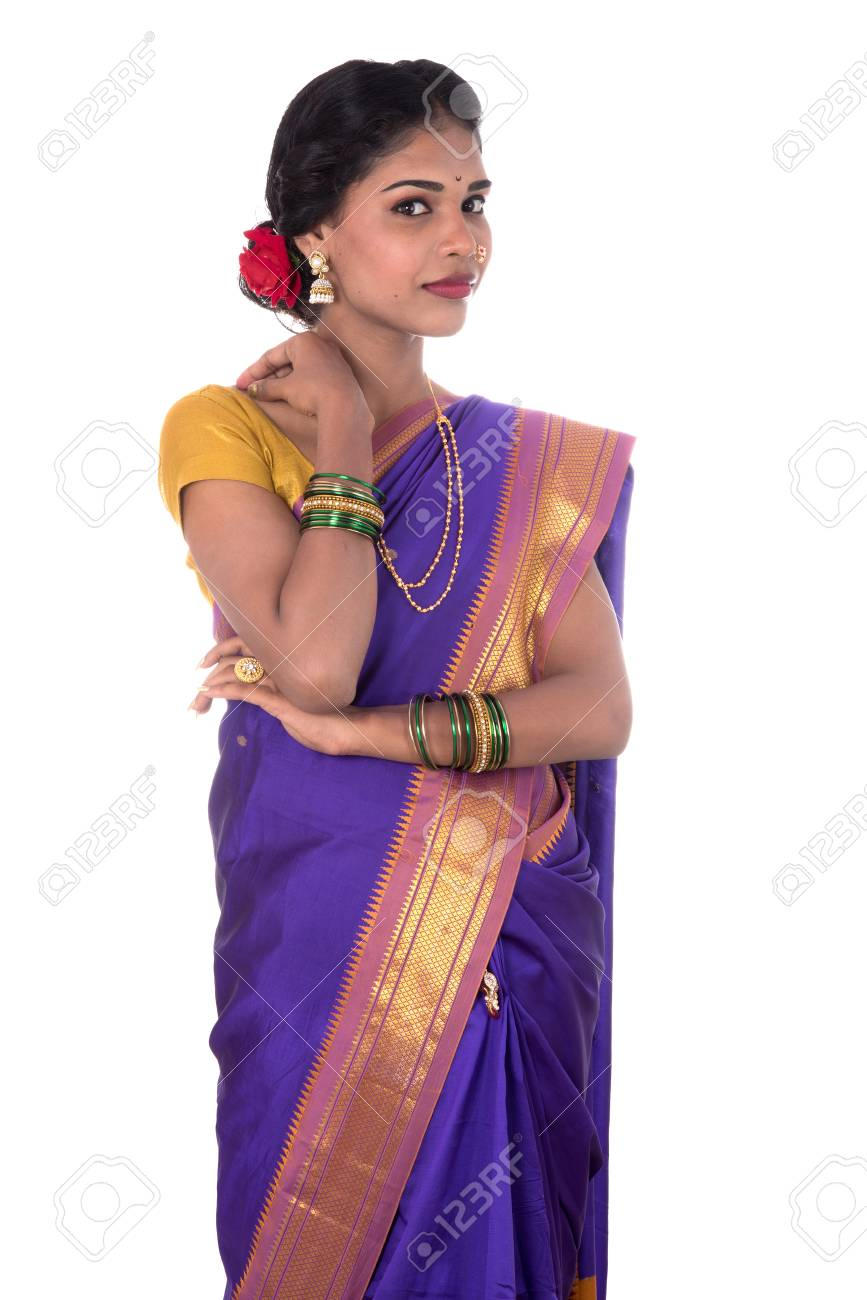119a79be49 Beautiful Indian young girl posing in traditional Indian saree on white  background. Stock Photo -
