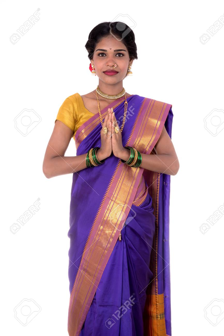 Young Indian Girl In Traditional Clothing Greeting Namaste Welcome