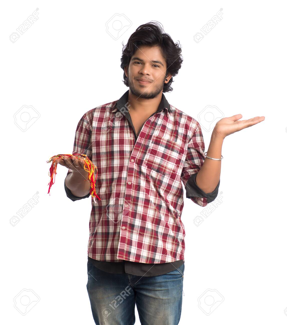 Young men showing rakhi in hand and giving expression on an occasion of Raksha Bandhan festival. - 147112167