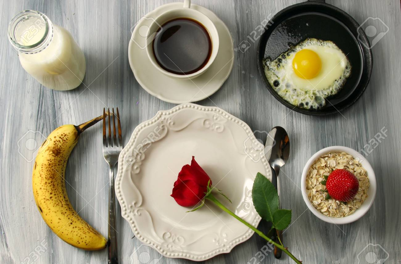 Overhead view of a romantic breakfast table setting with milk a banana coffee & Overhead View Of A Romantic Breakfast Table Setting With Milk ...