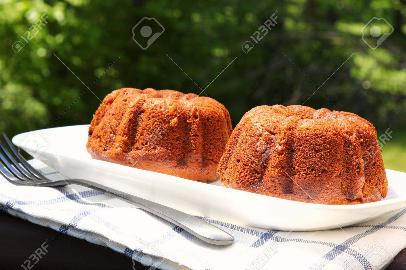 Small banana bread Bundt cakes on a wooden background with copy space Stock Photo - 79726643