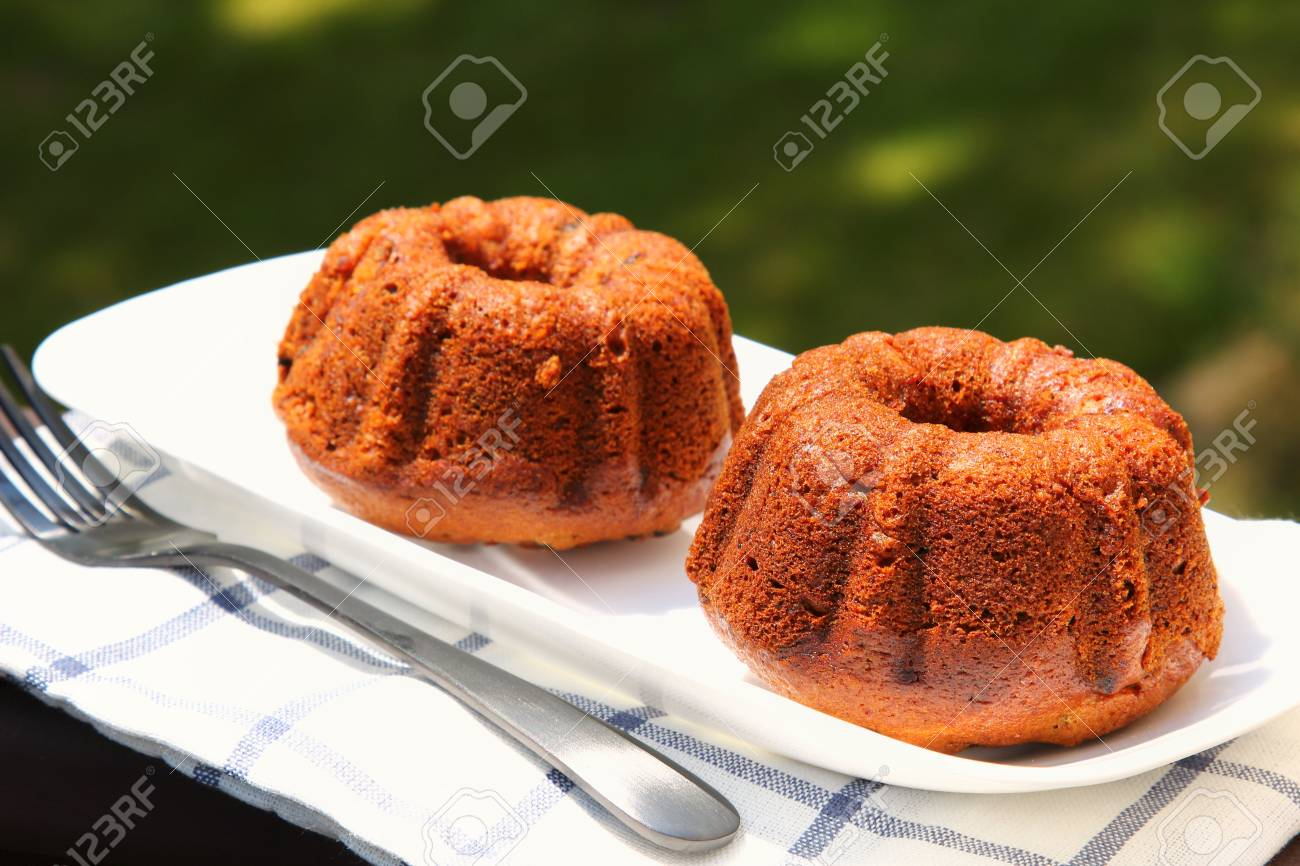Small banana bread Bundt cakes on a wooden background with copy space Stock Photo - 79726645