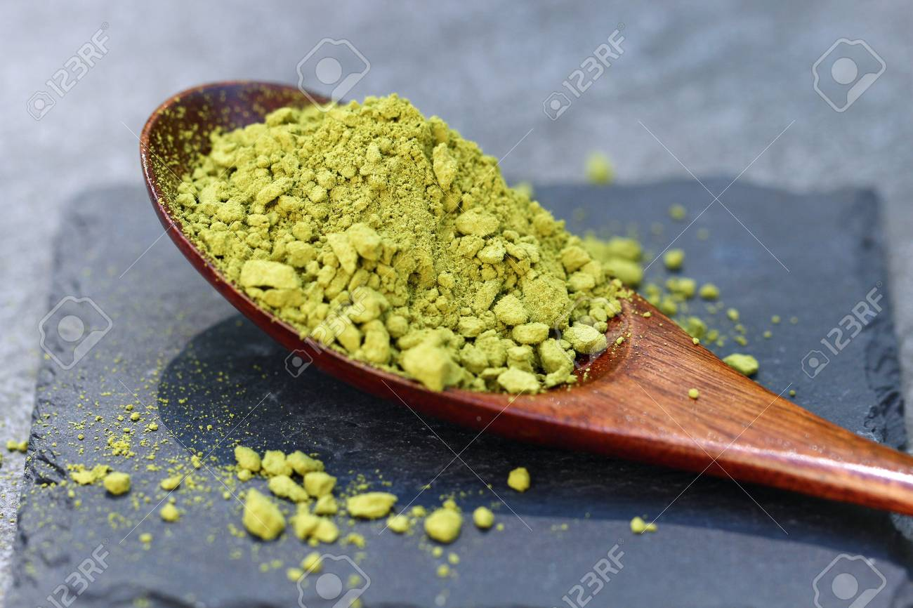 Green Matcha powder in a spoon on a slate colored tile, selective focus. Stock Photo - 79744126