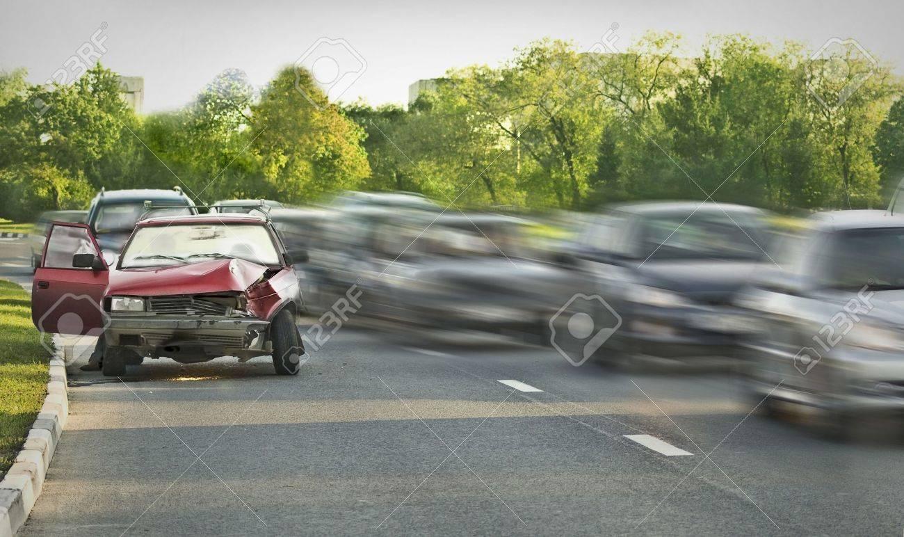 Crashed old car among traffic flow Stock Photo - 5380772