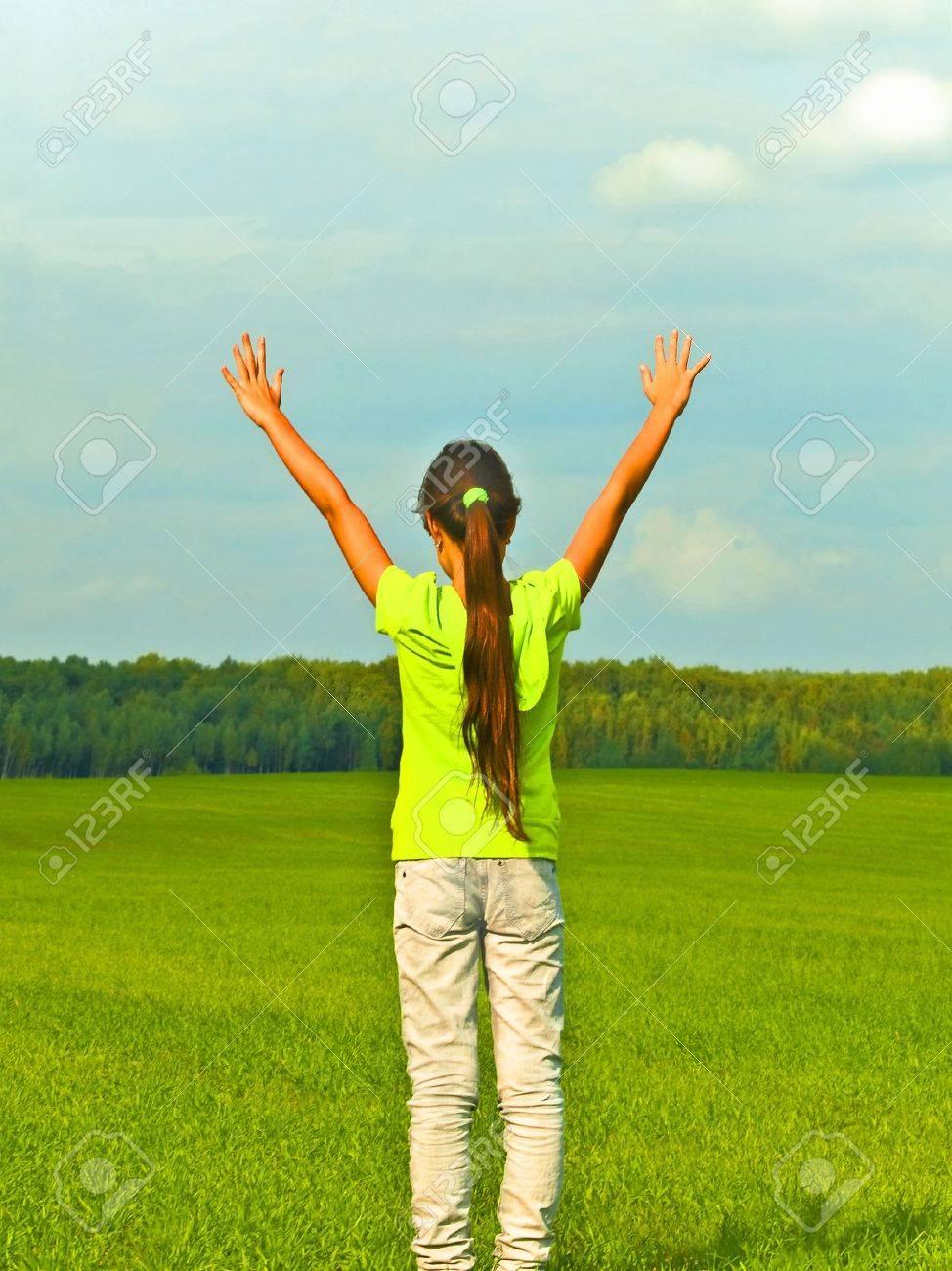 Joyful preteen girl in green field Stock Photo - 5586494