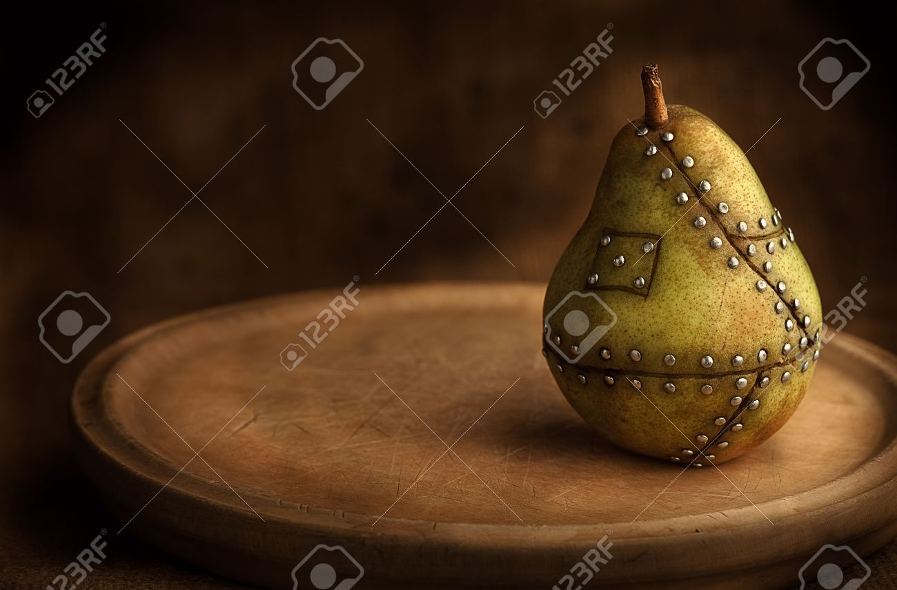 pear manipulated fruit with nails holding it together Stock Photo - 5965403