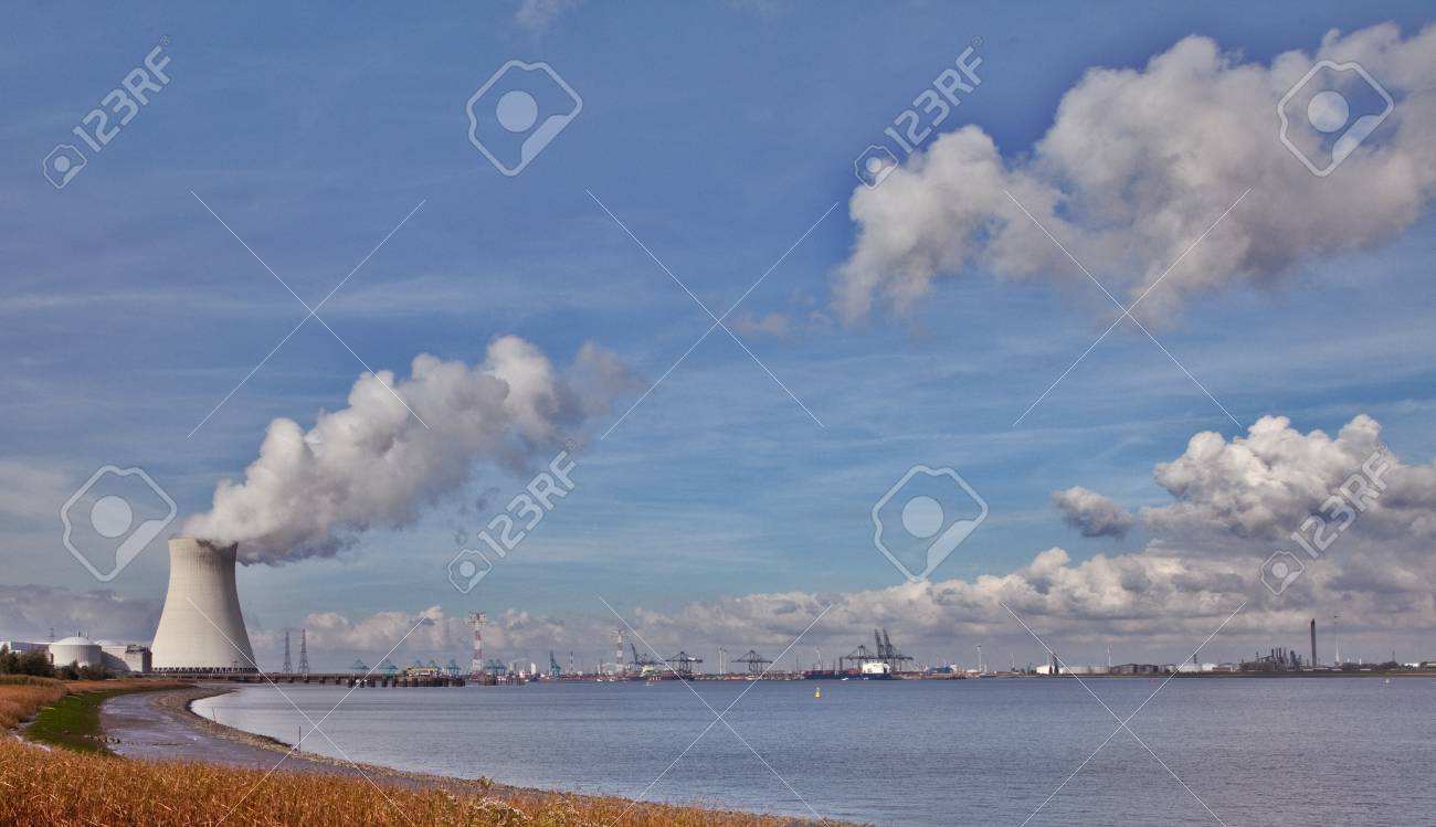 cooling towers of a nuclear power plant creating clouds in the Antwerp harbor Stock Photo - 9092714