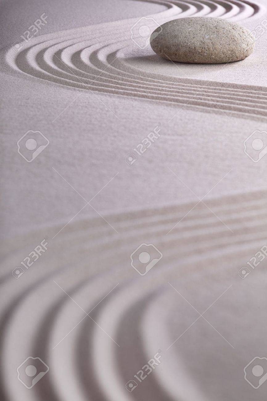 zen garden japanese garden zen stone with raked sand and round stone tranquility and balance ripples sand pattern Stock Photo - 9914400