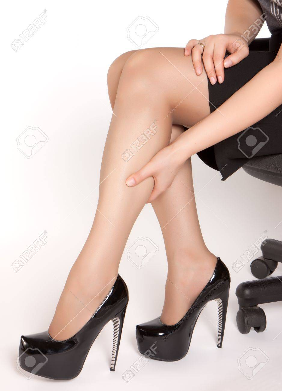 Women Wearing High Heels Black Shoes, Sitting On The Chair And ...