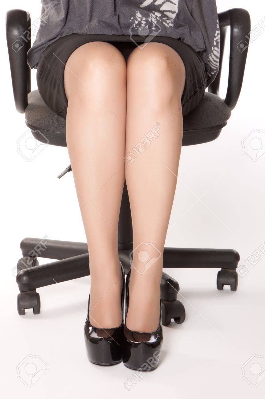 Photo Of Woman In Black Shoes Sitting In Chair Stock Photo   11030188