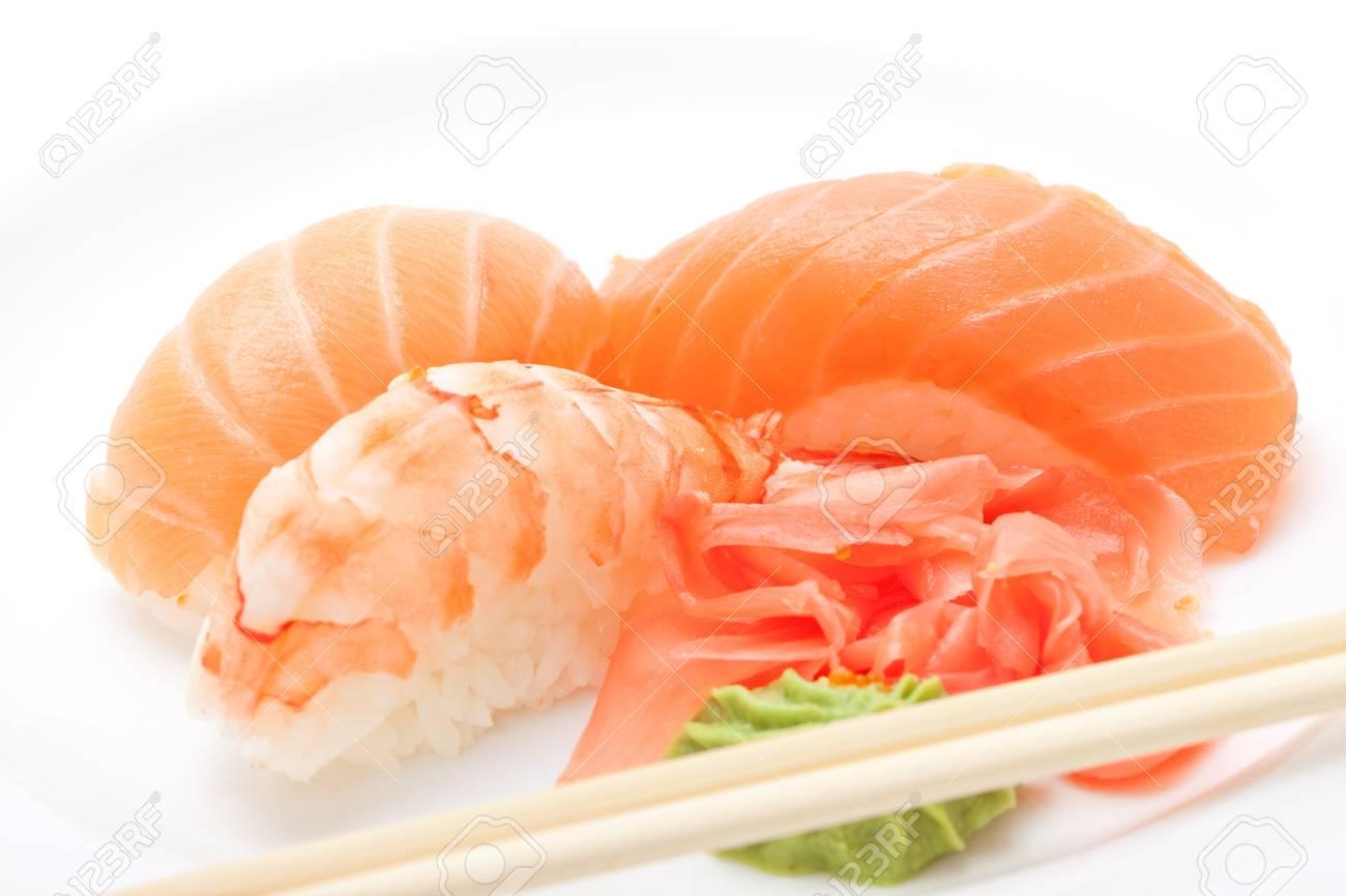 Sushi with chopsticks isolated over white background Stock Photo - 11534974
