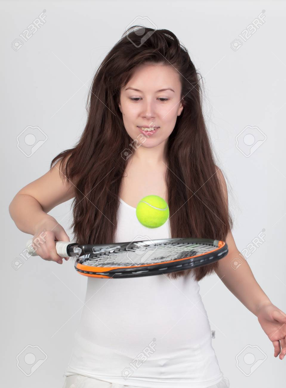 Young woman with tennis racket isolated on white Stock Photo - 12880256