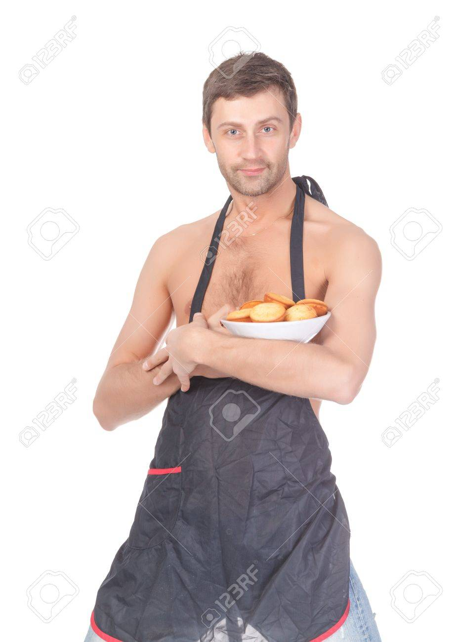 Attractive man trying his hand at baking wearing an apron and carrying a bowl of freshly baked cookies isolated on white Stock Photo - 15869950
