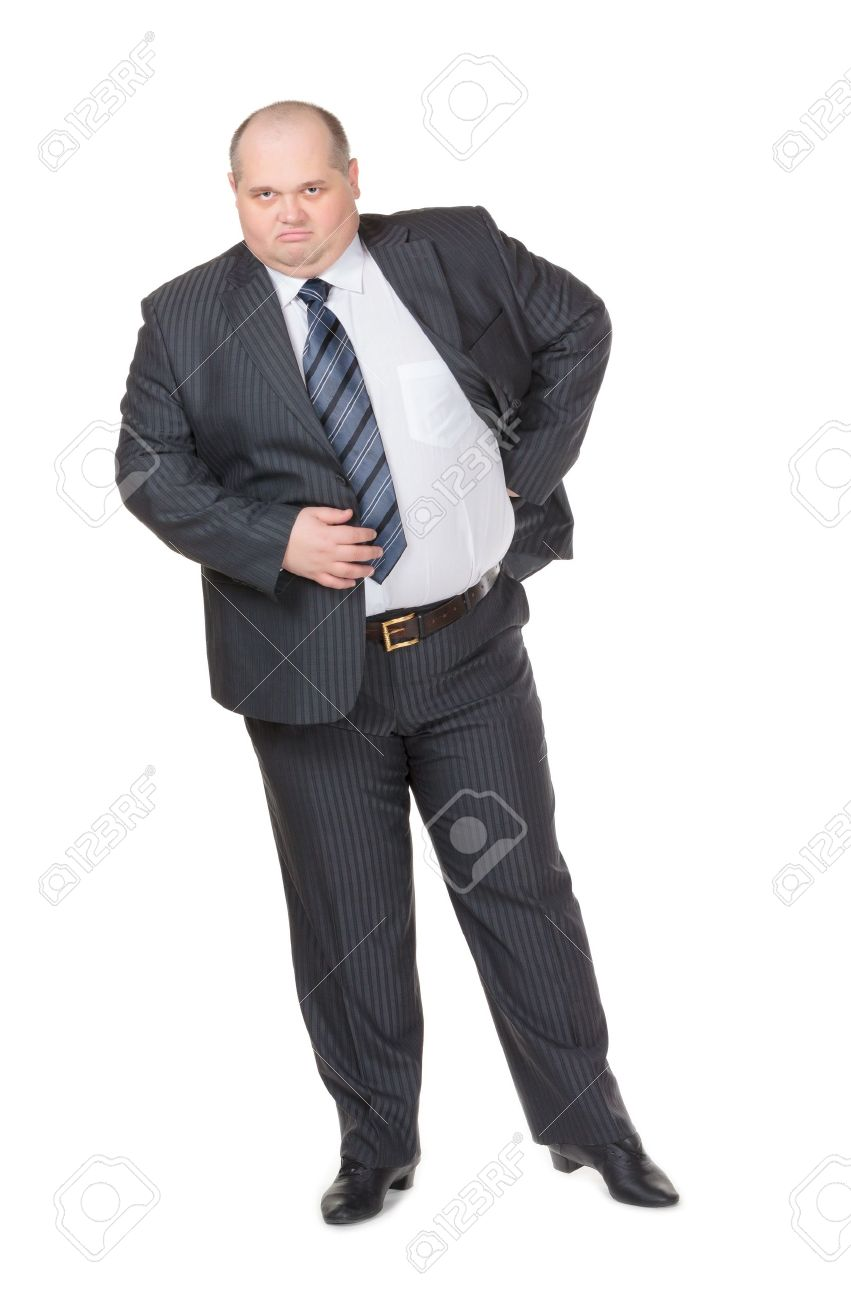 9e72374095b Fat overweight businessman in a stylish suit standing with his hand on his  hip glowering at