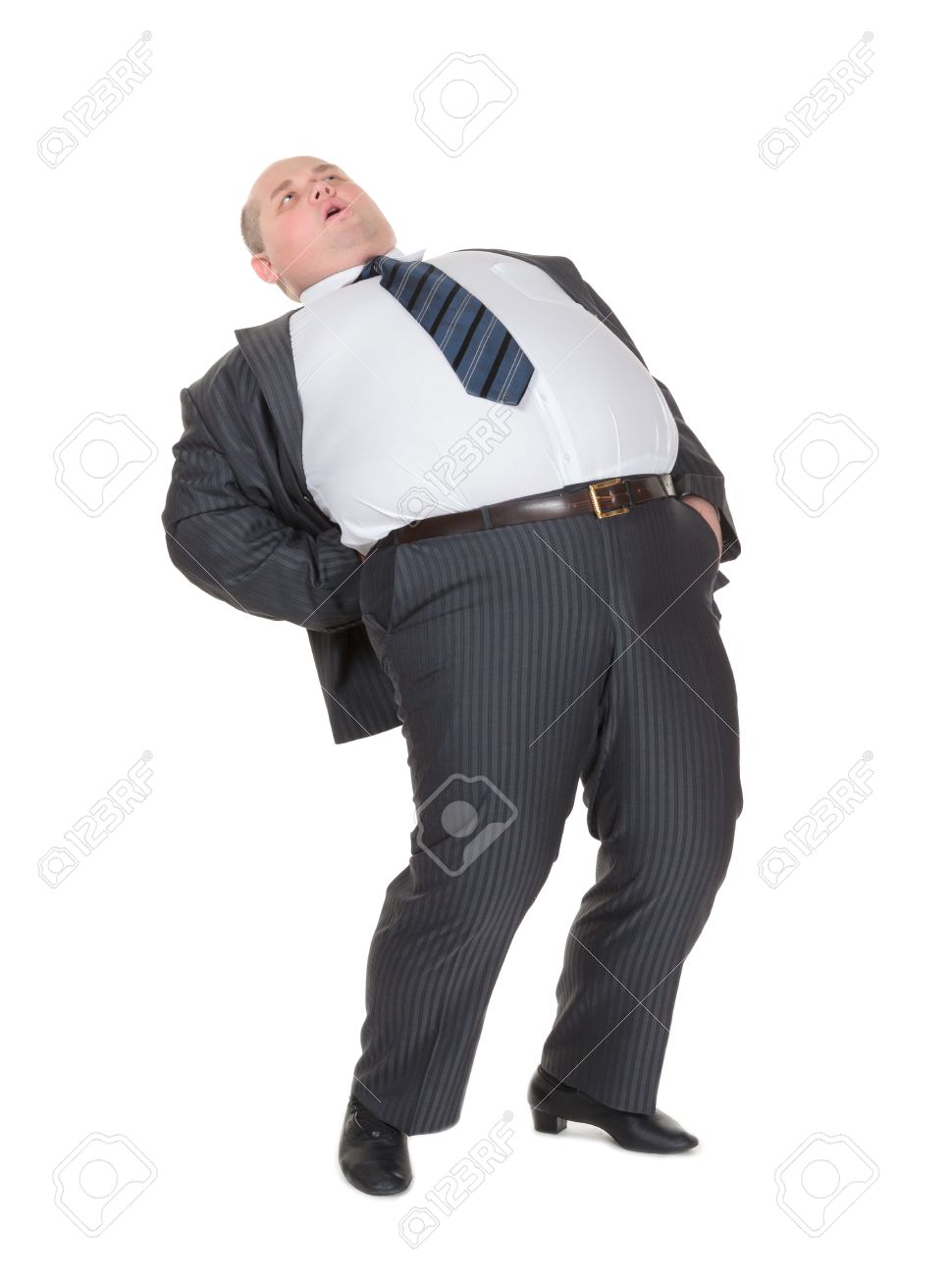 Very overweight man in a stylish suit and tie with acute back stock photo very overweight man in a stylish suit and tie with acute back ache bending over backwards to alleviate the pain with an agonised expression on ccuart Image collections