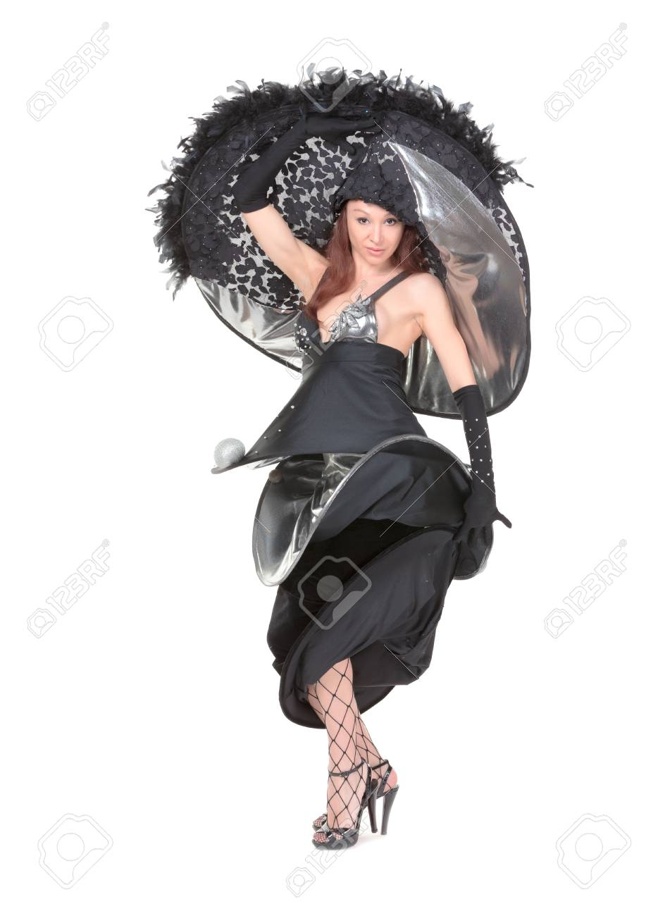 Beautiful young woman dressed in haute couture fashion wearing a modern stylish flamboyant evening outfit in black on a white background Stock Photo - 18217156