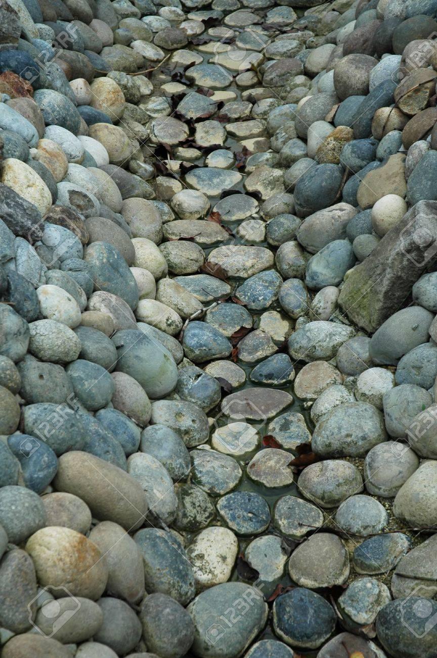 decorative rocks lining a dry streambed stock photo 300450 - Decorative Rocks