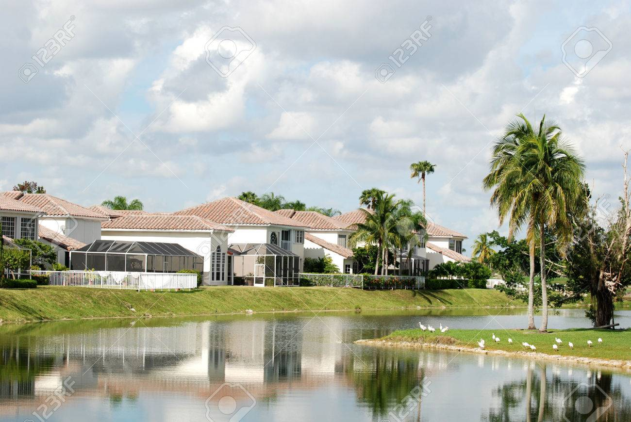 Houses against a canal, Miami, Florida Stock Photo - 1719544