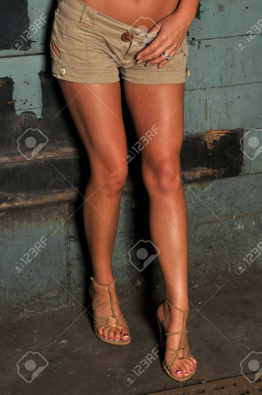 Tan shorts and long legs Stock Photo - 2923313