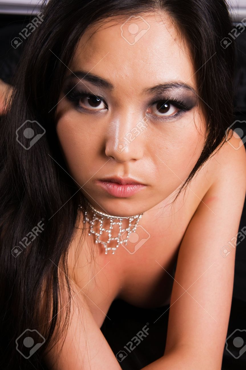 Beautiful young Japanese woman lying in bed - 5489152